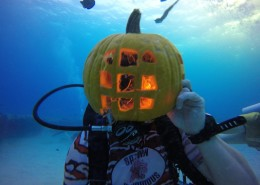 Scuba diver with pumpkin on his head